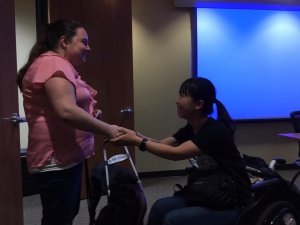 Shaking hands with a guide dog user at Mid-Atlantic ADA Center