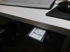 机の高さを変えるボタン