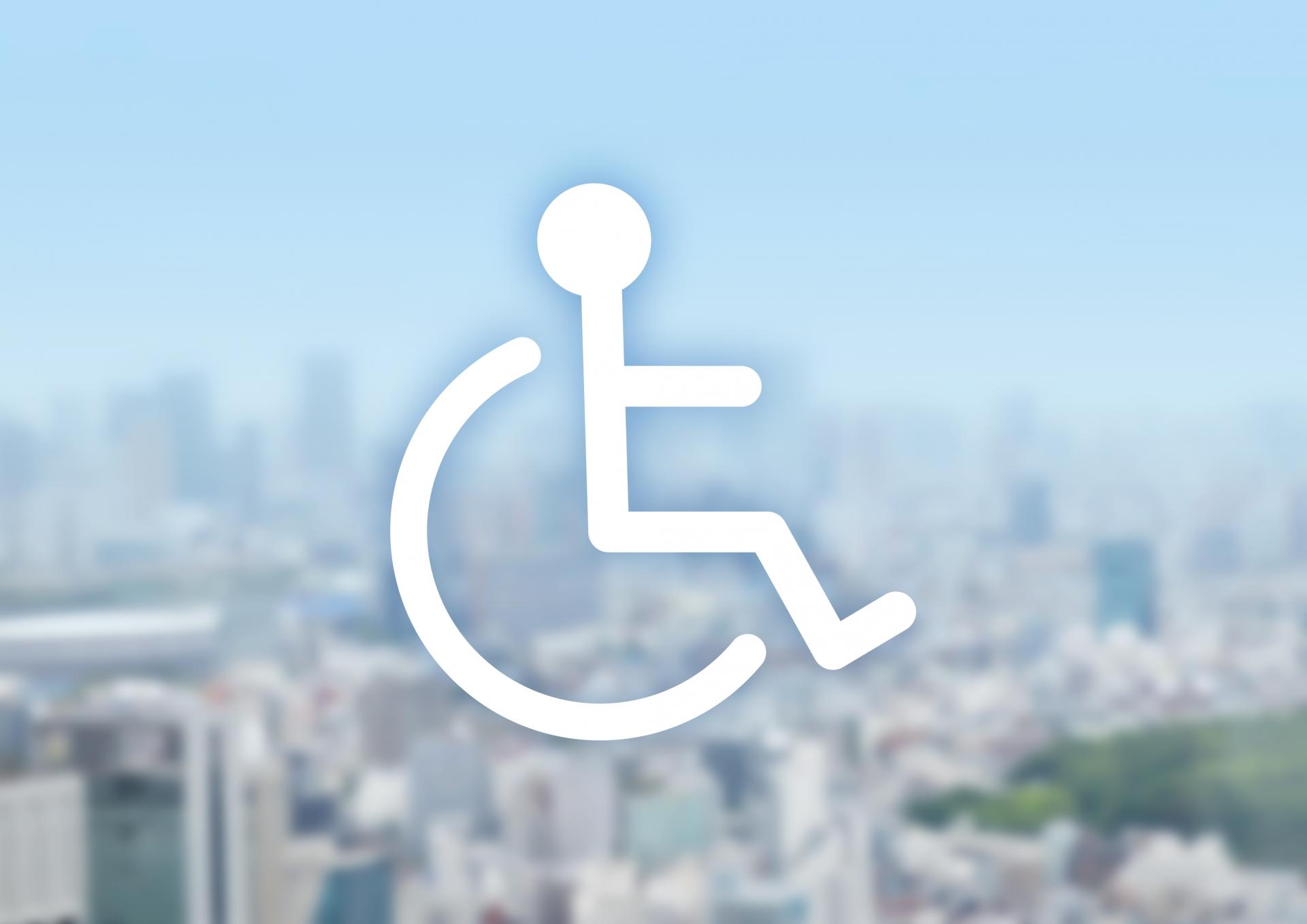 障害者シンボルマークと街並み